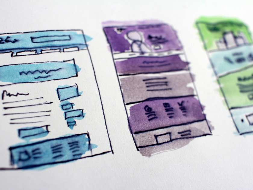 A doodle of web page designs on paper